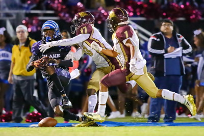 George P. Smith/The Montgomery Sentinel    Blake's Ben Hollomah II can't quite reel in this pass under heavy pressure from double team coverage by Paint Branch's Bobby Chaney Jr. (17) and Elijah Grooms (1).