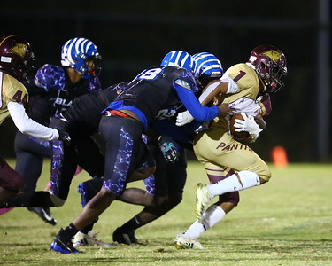 George P. Smith/The Montgomery Sentinel    Paint Branch's Elijah Grooms (1) gains yardage dragging Blake players along.