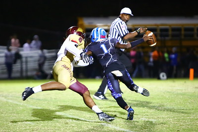 George P. Smith/The Montgomery Sentinel    The head referee runs for his life and Paint Branch's Ysaiahs Mohammed (6) flushes Blake's Isaiah Smith (1) out of the pocket.