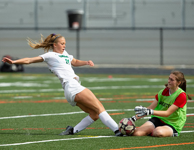 October 12, 2019 - Wheaton Goalkeeper Marianna Moreau gets to the ball just in time to stop the close-range shot by Walter Johnson's Caroline Williams. Moreau was able to stop all but two shots on goal as Wheaton fell 0-2 at home. Photo by Mike Clark/The Montgomery Sentinel