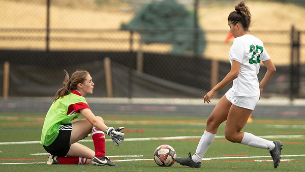October 12, 2019 - Wheaton Goalkeeper Marianna Moreau comes out of goal to stop this shot attempt by Walter Johnson's Olivia McBerry. Photo by Mike Clark/The Montgomery Sentinel