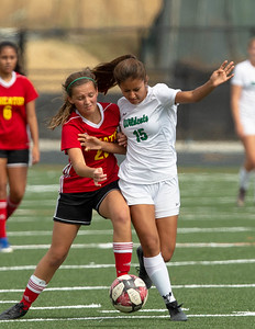 October 12, 2019 - Nicole Caceres of Walter Johnson battles Wheaton's Camille Bearman for the ball in the second half. Photo by Mike Clark/The Montgomery Sentinel