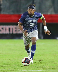 George P. Smith/The Montgomery Sentinel    Georgetown's Achara (20) brings the ball up the pitch for the Hoyas.