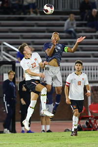 George P. Smith/The Montgomery Sentinel    Georgetown's Derek Dodson (9) with the header as Maryland's Nick Richardson (22) and Eli Crognate (10) look on.