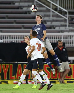 George P. Smith/The Montgomery Sentinel    Georgetown's Sean Zawadzki (6) with the header over Maryland's Eric Matzelevich (15) and Justin Harris (20).