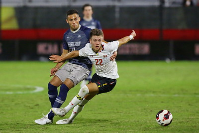 George P. Smith/The Montgomery Sentinel    Georgetown's Jack Beer (11) and Maryland's Nick Richardson (22).
