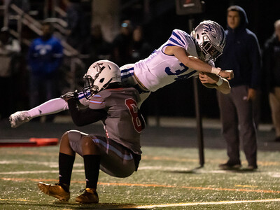 October 18, 2019 - Sherwood's Dylan Grant dives into the endzone for one of the six Warrior touchdowns for a 41-0 win over host Einstein. Photo by Mike Clark/The Montgomery Sentinel