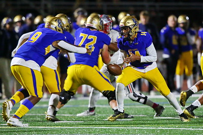 George P. Smith/The Montgomery Sentinel    Good Counsel's Chase Williams (14) handing faking the hand off to fullback Di'Moni Dickerson (9).