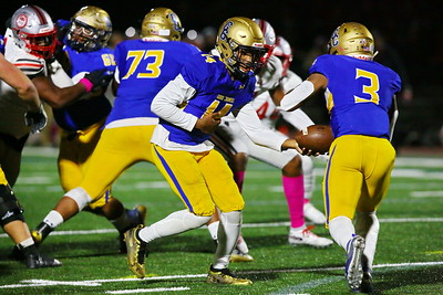 George P. Smith/The Montgomery Sentinel    Good Counsel's Chase Williams (14) handing off to Sy'Veon Wilkerson (3).