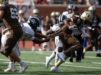 October 19, 2019 - Landon Running Back Tyler Smith drags Georgetown Prep defenders in the first half. Photo by Mike Clark/The Montgomery Sentinel