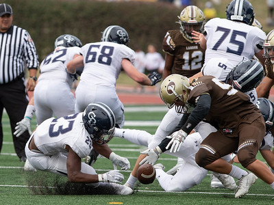 October 19, 2019 - Georgetown Prep  Running Back Jalen Hampton is stripped of the ball by Landon's Edward Bou but Hampton recovered. Photo by Mike Clark/The Montgomery Sentinel