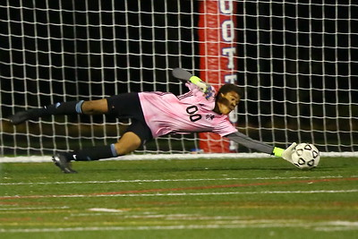 George P. Smith/The Montgomery Sentinel    Wootton's  Austin Mboijana (00) with a save.