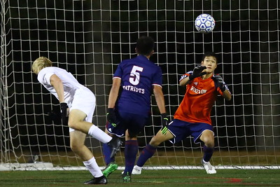 George P. Smith/The Montgomery Sentinel    Wootton's goalie Jonathan Lee (0) did a good job of stopping this crossing header by Whitman's Christopher Vogel (12).