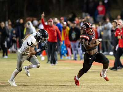October 25, 2019 - Marquez Cooper of Quince Orchard races to the endzone and racks up 161 yards on 25 carrys against Northwest. Photo by Mike Clark/The Montgomery Sentinel