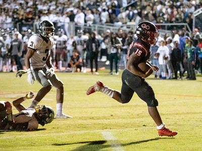 October 25, 2019 - Star Running Back Marquez Cooper of Quince Orchard leaves behind Northwest tacklers as he scores the first of his two touchdowns and 161 yards of rushing in the 17-7 win. Photo by Mike Clark/The Montgomery Sentinel