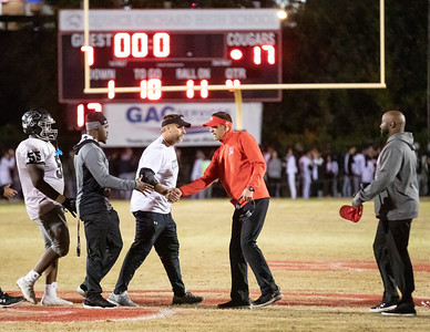 October 25, 2019 - In a battle of the unbeaten 4A West teams, host Quince Orchard takes down Northwest 17-7 after a scoreless first half. Coaches Kelly and Neubeiser shake hands. Photo by Mike Clark/The Montgomery Sentinel