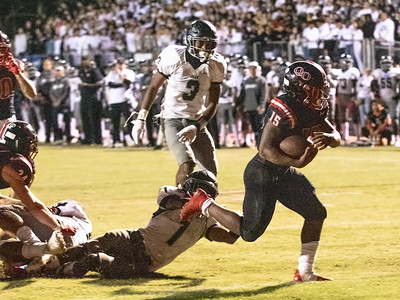 October 25, 2019 - Star Running Back Marquez Cooper of Quince Orchard drags Logan Bartolomeo of Northwest across the goal line for the first of his two touchdowns and 161 yards of rushing in the 17-7 win. Photo by Mike Clark/The Montgomery Sentinel