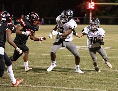 October 25, 2019 - Northwest's Ryan Beach (10) runs behind Kaden Prather (3) but the Quince Orchard defense closes quickly. The Northwest Jaguars were limited to 7 points in a 17-7 loss to the undefeated Quince Orchard Cougars. Photo by Mike Clark/The Montgomery Sentinel