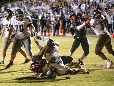 October 25, 2019 - Northwest Jaguar's Ajahni Terry dives into the endzone for the lone Northwest score against Quince Orchard. Photo by Mike Clark/The Montgomery Sentinel