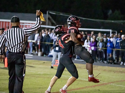 October 25, 2019 - Justin Moran (24) helps lifts Marquez Cooper after the touchdown score for Quince Orchard but is flagged for excessive celebration. Photo by Mike Clark/The Montgomery Sentinel