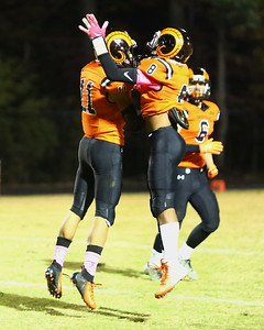 George P. Smith/The Montgomery Sentinel    Rockville's Giancarlo Roach (11) celebrates with teammate Gio Roach (8) after Giancarlo Roach (11) intercepted a Richard Montgomery pass.
