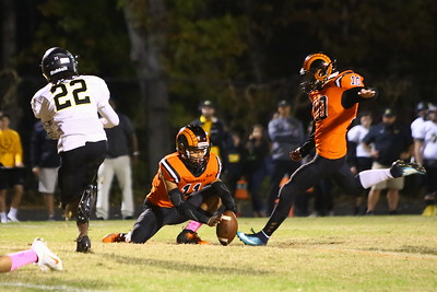 George P. Smith/The Montgomery Sentinel    Richard Montgomery's Xavier Ricks (22) blocked the PAT by Cristobal Pena (10) off the hold by Giancarlo Roach (11).