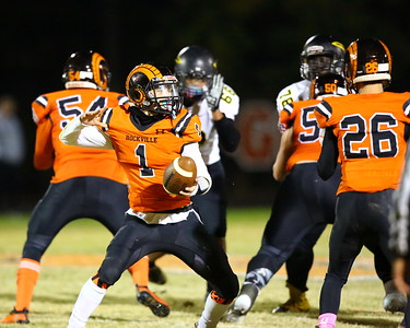 George P. Smith/The Montgomery Sentinel    In a cool play Rockville's Dylan Monday (1) fakes the throw and hands off to Erik Howard (26).