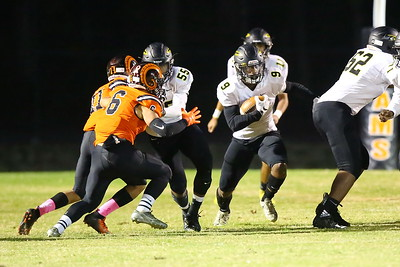 George P. Smith/The Montgomery Sentinel    Richard Montgomery's T'Kai Ayoola (9) hits a big hole in the Rockville line.