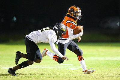 George P. Smith/The Montgomery Sentinel    Richard Montgomery's Xavier Ricks (22) catches up to Rockville quarterback Dylan Monday (1) running the ball on a keeper.