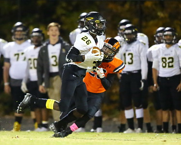 George P. Smith/The Montgomery Sentinel    Richard Montgomery's Daryl Harper (26) makes a catch as Rockville's Erik Howard (26) holds on to his jersey to bring him down.