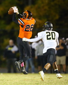 George P. Smith/The Montgomery Sentinel    Rockville's Erik Howard (26) pulls in a catch in front of Richard Montgomery's Jaime Castro (20).