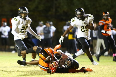 George P. Smith/The Montgomery Sentinel    Rockville's Marquez Platt (7) holds on to the ball for a catch despite the efforts by Richard Montgomery's Xavier Hicks (22) to dislodge the ball after Platt bobbled it.