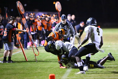 George P. Smith/The Montgomery Sentinel    Richard Montgomery's Daryl Harper (26) drives Rockville's Marquez Platt (7) out of bounds just before the pylon.