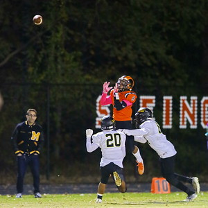 George P. Smith/The Montgomery Sentinel    Rockville's Gio Roach (8) waits for the ball as Richard Montgomery's Jaime Castro (20) andLeroy Neal (84) converge to cover.