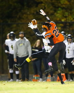George P. Smith/The Montgomery Sentinel    Richard Montgomery's Daryl Harper (26) makes a catch as Rockville's Erik Howard (26) tries to swat it out of his hands.