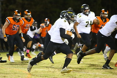 George P. Smith/The Montgomery Sentinel    Richard Montgomery's T'Kai Ayoola (9) builds up a head of steam running against Rockville.