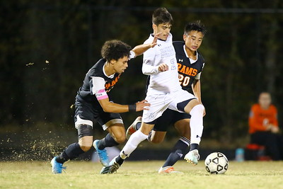 George P. Smith/The Montgomery Sentinel    Blake's Jesus Avelar (2) drives between Rockville's Felix Rivera (10) and Jefferson Perez (20), a freshman, who would score one of Rockville's goals.