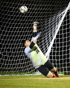 George P. Smith/The Montgomery Sentinel    Blake's goalie Anthony Lucero (30) guesses correctly and successfully blocks a Rockville penalty kick.