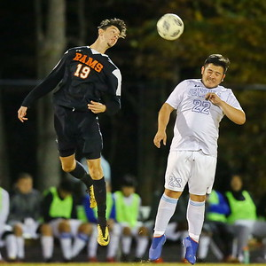 George P. Smith/The Montgomery Sentinel    Rockville's Luis Ruano (19) with the header against Blake's Nestor Mendez (22).