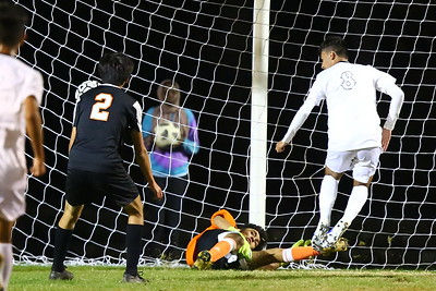 George P. Smith/The Montgomery Sentinel    Rockville goalie Juan Martinez (26) saves a goal by forcing the shot by  Blake's Kevin Kontreras (8) wide right past the goal post.