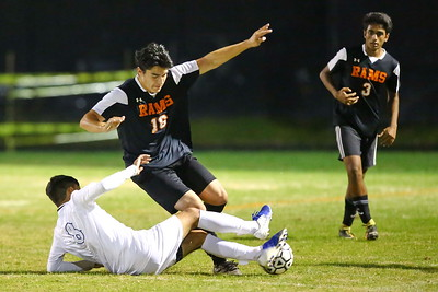George P. Smith/The Montgomery Sentinel    Blake's Kevin Contreras (8), who would later get a yellow card, tries to sweep the ball out from under Rockville's Amadore Soto (16).