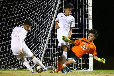 George P. Smith/The Montgomery Sentinel    Rockville's sophomore goalie Juan Martinez (26) is chucked by Blake's Carlos Valencia (7) as he tries to clear the ball allowing Michael Zelaya (21) to send the ball into the net but Zelaya was ruled off side and the goal did not count.