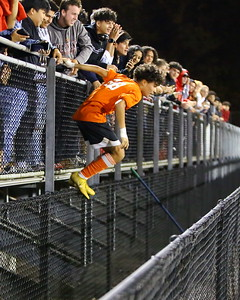 George P. Smith/The Montgomery Sentinel    Rockville's sophomore goalie Juan Martinez (26) celebrates with fans in the student section after the Rams defeated the Bengals 2-1 to capture the 3A West Region II title at home.