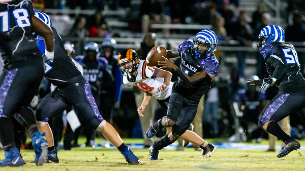 November 1, 2019 - Isaiah Smith scrambles out of the Blake pocket to avoid the Rockville pass rush. Photo by Mike Clark/The Montgomery Sentinel