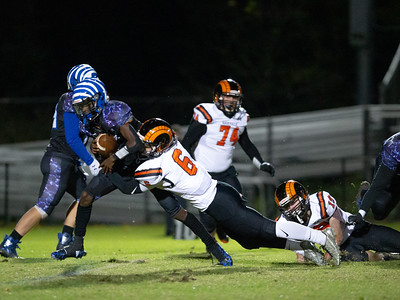 November 1, 2019 - Blake Quarterback Isaiah Smith is taken down by Rockville's Conor Pace. Blake's offense was limited to six points in the 22-6 home loss.  Photo by Mike Clark/The Montgomery Sentinel