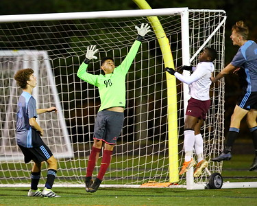 George P. Smith/The Montgomery Sentinel    Bladensburg's goalie Jose Campos Portillo (98) goes up to block a  shot to the upper left corner.