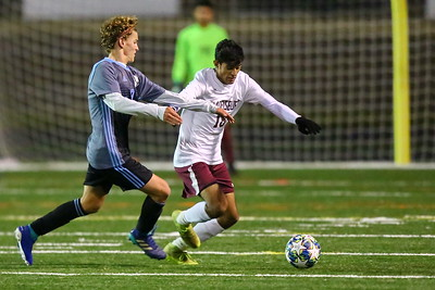George P. Smith/The Montgomery Sentinel    Whitman's Hugo Barnes (9) and Bladensburg's Waheed Hamidi (18) battle for control of the ball.
