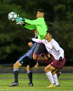 George P. Smith/The Montgomery Sentinel    Bladensburg goalie Jose Campos Portillo (98) goes airborne to snag the ball.
