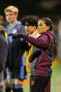 George P. Smith/The Montgomery Sentinel    Bladensburg head coach Juliana Ocampos-Barry points out something on the field to a player waiting to go in.