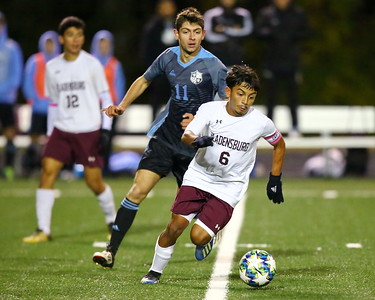 George P. Smith/The Montgomery Sentinel    Bladensburg's Isaac Sales Torres (6) dribbles the ball in front of Whitman's Neema Amalemansour (11).